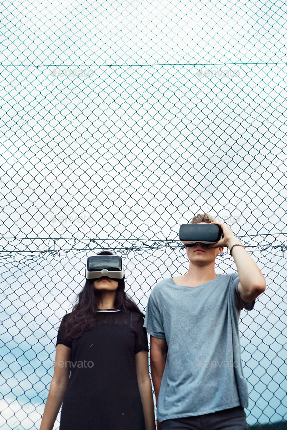 Attractive teenagers on playground with VR glasses. - Stock Photo - Images