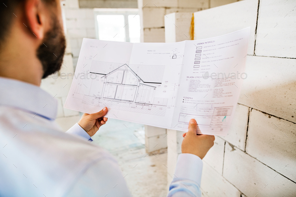 Architect or civil engineer at the construction site. - Stock Photo - Images