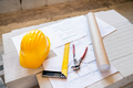 Pliers, square, helmet and blueprints on construction site. - PhotoDune Item for Sale