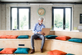 Mature businessman with laptop in creative office. - PhotoDune Item for Sale