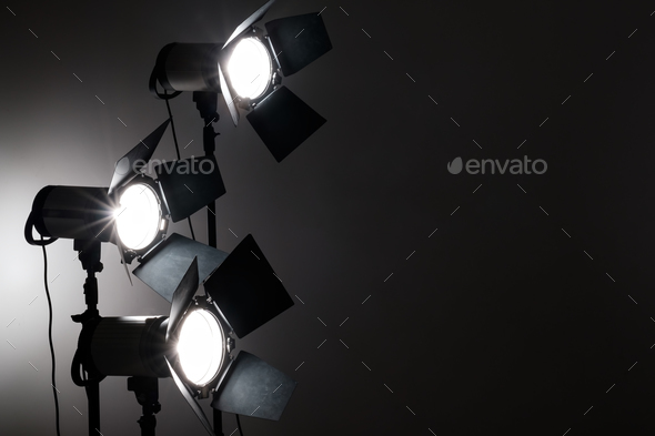 Several reflectors on the black background in photo studio. - Stock Photo - Images