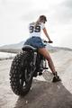 Biker girl and vintage custom motorcycle