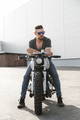 Rider guy with classic style cafe racer motorcycle - PhotoDune Item for Sale