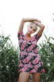 Girl between green leaves in a corn field - PhotoDune Item for Sale