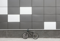 Bicycle leaning on grey wall - PhotoDune Item for Sale
