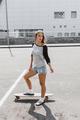 Girl with longboard - PhotoDune Item for Sale