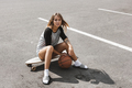 Girl sits on longboard - PhotoDune Item for Sale