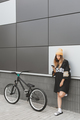 Girl in hockey jersey style with street bicycle - PhotoDune Item for Sale
