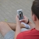 A Male Hand Holding A Smart Phone During A Video Call With His Friend - VideoHive Item for Sale