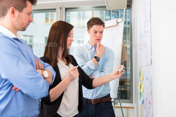 Colleagues With Adhesive Notes Standing In Office - Stock Photo - Images