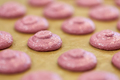 macaron batter or meringue cream on baking paper