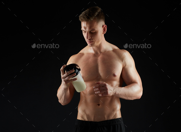 young man or bodybuilder with protein shake bottle - Stock Photo - Images