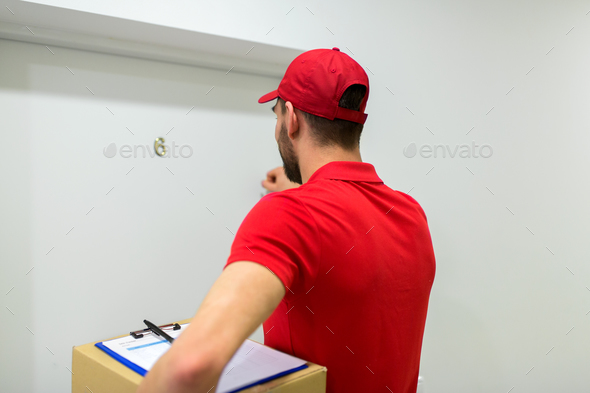 delivery man with parcel box knocking door - Stock Photo - Images