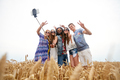 hippie friends with smartphone on selfie stick - PhotoDune Item for Sale