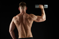 man with dumbbells exercising