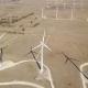 Windmills Producing Electricity in Desert