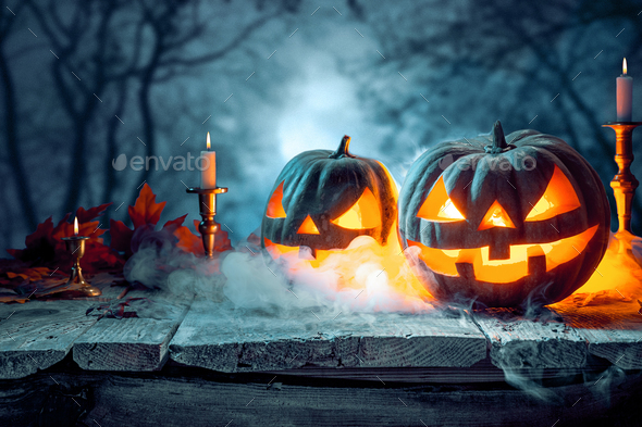 Halloween pumpkins on blue background - Stock Photo - Images