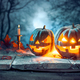 Download Halloween pumpkins on blue background from PhotoDune