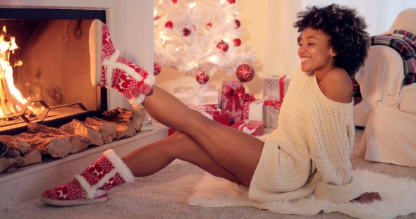 Trendy Vivacious Woman Wearing Christmas Booties