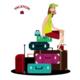 Tourist Sitting on a Luggage