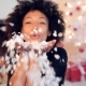 Adorable Sexy Woman Blowing Out Confetti