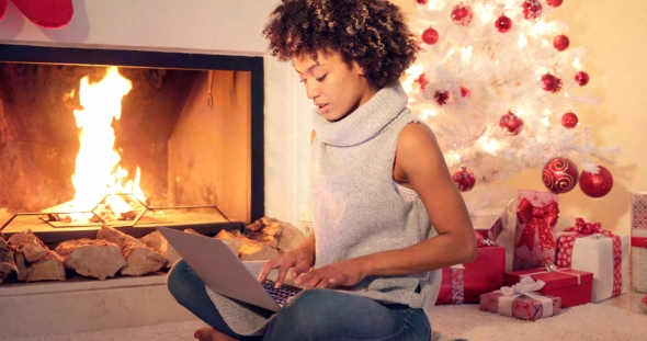 Chic Young Woman Typing a Christmas Message