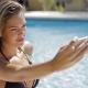 Confident Model Taking Selfie in Pool