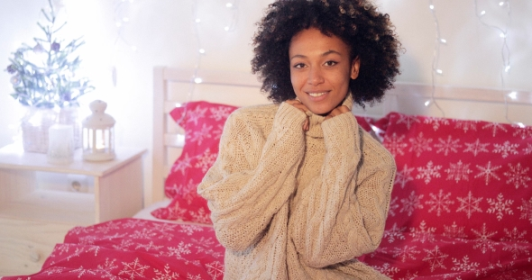 Pretty Young African Woman in a Christmas Bedroom