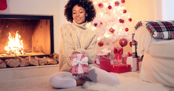 Pretty African American Woman Holds Christmas Gift