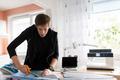fashion designer cutting fabric at studio