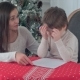 Young Mother Helping Her Struggling Son To Write a Letter To Santa Claus - VideoHive Item for Sale