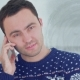 Young Man in Christmas Sweater Talking on the Phone - VideoHive Item for Sale