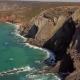 Huge Cliffs on Ocean Shore