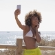 Content Girl Taking Selfie on Beach - VideoHive Item for Sale