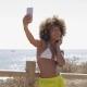 Content Girl Taking Selfie on Beach