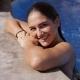 Smiling Girl Posing Wet in Pool