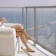 Woman Enjoying Morning on Hotel Balcony