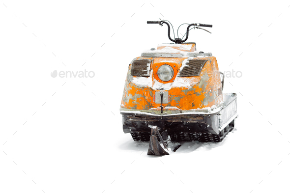 Old snowmobile. Isolated on white background - Stock Photo - Images