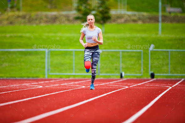 Young Female In Sportswear Running On Sports Tracks - Stock Photo - Images