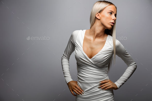 Beautiful Woman With Hands On Hip Looking Away - Stock Photo - Images