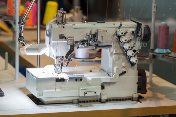 Sewing machine and cloth in cutting shop, nobody - Stock Photo - Images