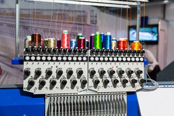 Sewing machine with spools of thread closeup - Stock Photo - Images