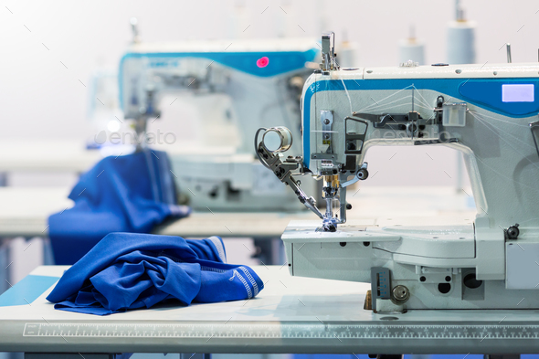 Sewing machines, nobody, cloth industry - Stock Photo - Images