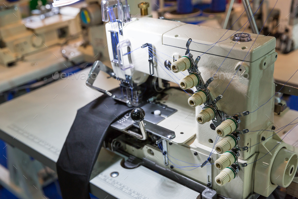 Sewing machine and cloth, nobody, clothing factory - Stock Photo - Images