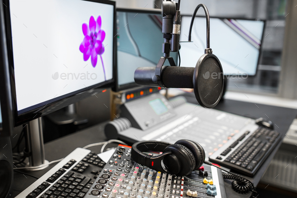 Microphone, Music Mixers And Headphones By Monitors In Radio Stu - Stock Photo - Images