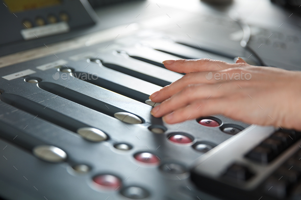 Radio Host Using Music Mixer In Studio - Stock Photo - Images