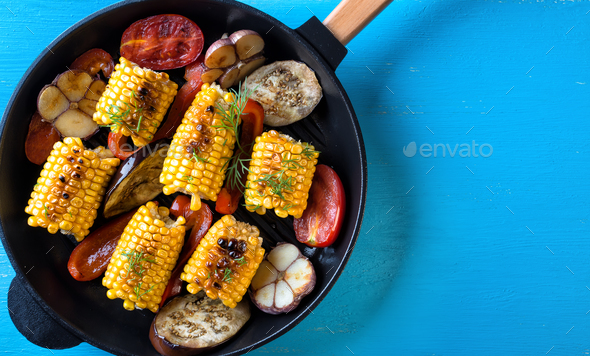 Baked in a frying pan corn and vegetables - Stock Photo - Images