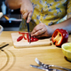 Closeup of hands cutting bell pepper in the kitchen - PhotoDune Item for Sale