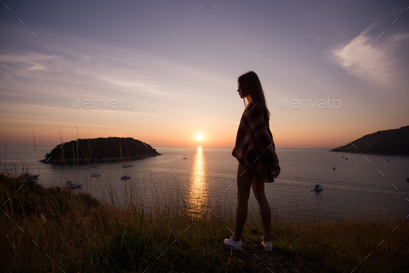 young freedom woman enjoy ocean sunset on mountain peak - Stock Photo - Images