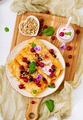 Pancakes with yoghurt, honey, nuts and summer berries. Tasty breakfast. Flat lay. Top view
